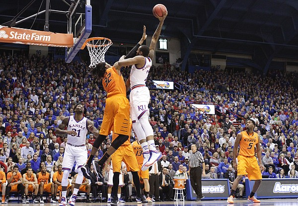 Kansas forward Cliff Alexander (2) takes some contact from Oklahoma State forward/center Anthony Allen Jr. (32) as he elevates for a dunk during the first half, Tuesday, Jan. 13, 2015 at Allen Fieldhouse.