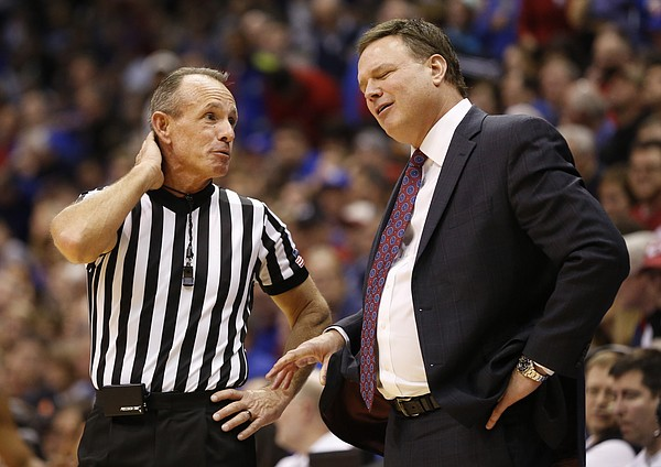 Kansas head coach Bill Self and official Darron George during the second half, Tuesday, Jan. 13, 2015 at Allen Fieldhouse.