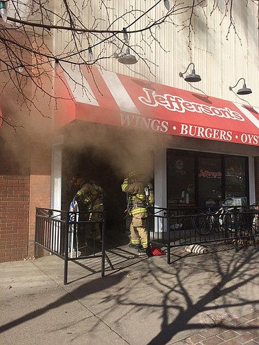 Firefighters investigate a fire at Jefferson's, 743 Massachusetts St., on Jan. 15.