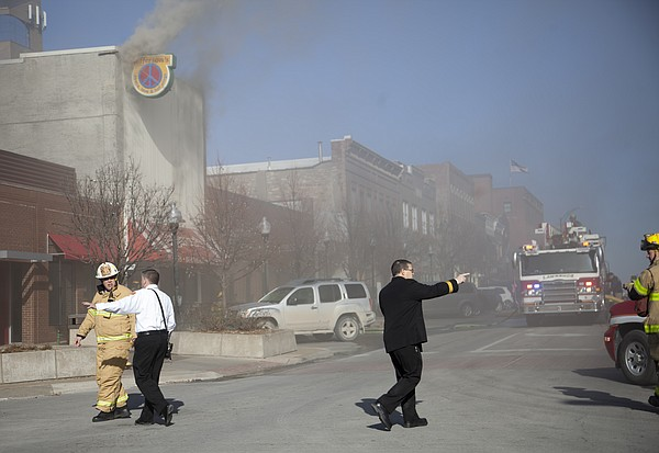 Firefighters respond to heavy smoke and reports of fire at Jeffersons, 8th and Massachusetts streets, Thursday, Jan. 15, 2015.