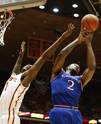 Kansas forward Cliff Alexander (2) fights for a rebound with Iowa State forward Jameel McKay (1) during the first half on Saturday, Jan. 17, 2015 at Hilton Coliseum.