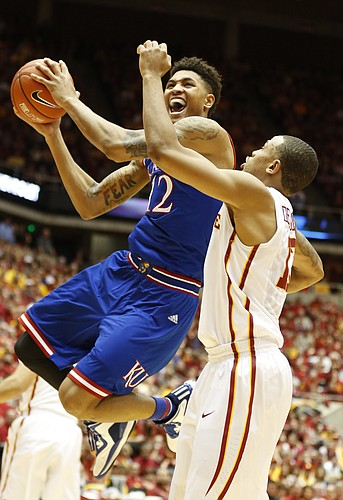 Kansas guard Kelly Oubre Jr. (12) heads to the bucket against Iowa State guard Bryce Dejean-Jones (13) during the first half on Saturday, Jan. 17, 2015 at Hilton Coliseum.