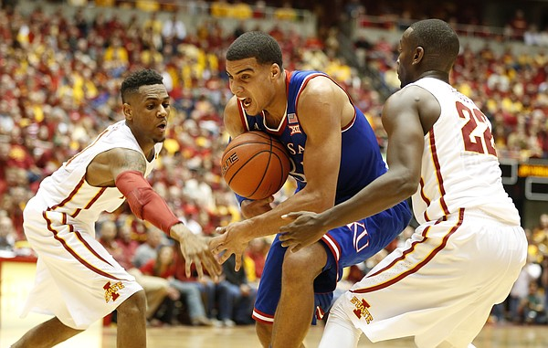 Kansas forward Landen Lucas (33) loses the ball as it is stripped by Iowa State forward Dustin Hogue (22) and guard Monte Morris (11) during the first half on Saturday, Jan. 17, 2015 at Hilton Coliseum.