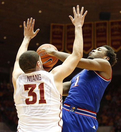 Kansas guard Wayne Selden Jr. (1) hangs for a shot against Iowa State forward Georges Niang (31) during the first half on Saturday, Jan. 17, 2015 at Hilton Coliseum.