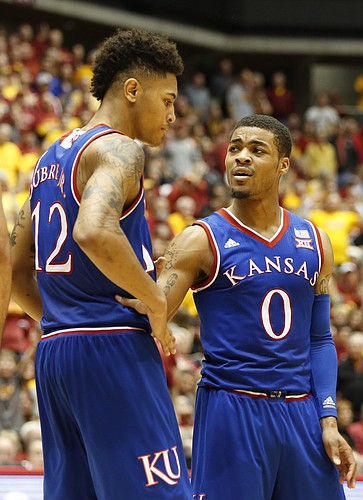 Kansas guard Frank Mason III (0) tries to settle down teammate Kansas guard Kelly Oubre Jr. (12) during the second half on Saturday, Jan. 17, 2015 at Hilton Coliseum.