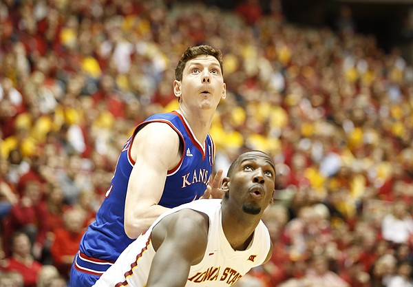 Kansas forward Hunter Mickelson and Iowa State forward Dustin Hogue await a rebound during the second half on Saturday, Jan. 17, 2015 at Hilton Coliseum.
