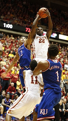 Iowa State forward Dustin Hogue (22) pulls away a rebound from Kansas guard Kelly Oubre Jr. (12) with a minute remaining in regulation on Saturday, Jan. 17, 2015 at Hilton Coliseum.