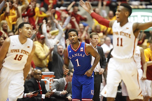 Kansas guard Wayne Selden Jr. (1) casts a stunned expression as Iowa State players and fans celebrate a three by the Cyclones during the second half on Saturday, Jan. 17, 2015 at Hilton Coliseum.