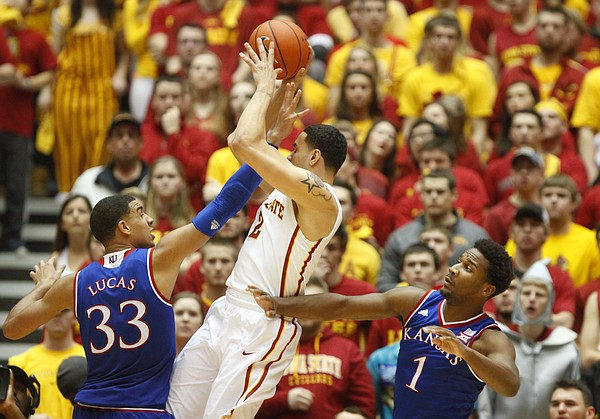 Iowa State forward Abdel Nader (2) is defended by Kansas forward Landen Lucas (33) and guard Wayne Selden Jr. during the second half on Saturday, Jan. 17, 2015 at Hilton Coliseum.