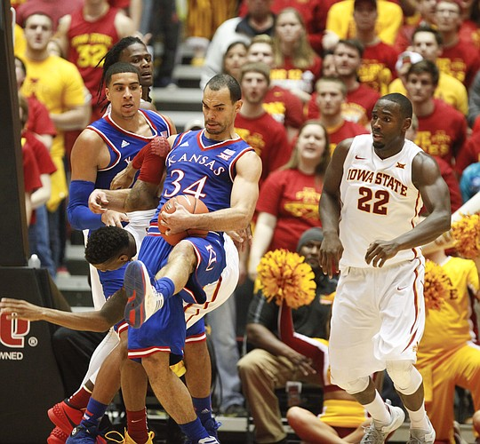 Kansas forward Perry Ellis (34) pulls a rebound away from Iowa State guard Monte Morris during the second half on Saturday, Jan. 17, 2015 at Hilton Coliseum. Also pictured are Kansas forward Landen Lucas and Iowa State forward Dustin Hogue.