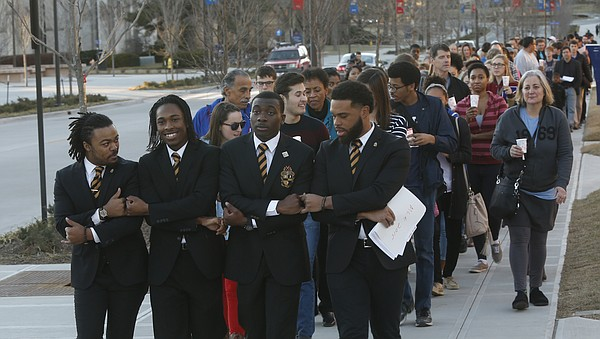 Members of the Alpha Phi Alpha fraternity from across the United States marched with hundreds of others Monday, Jan. 19, 2015, from Kansas University's Strong Hall to the Kansas Union. In the front row, from left, are Kareeem Wall, Elden Mitchell, DeVante Green and Adam Khalil.