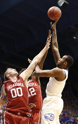 Kansas forward Cliff Alexander (2) turns for a shot over Oklahoma forward Ryan Spangler (00) and forward Khadeem Lattin (12) during the first half on Monday, Jan. 19, 2015 at Allen Fieldhouse.
