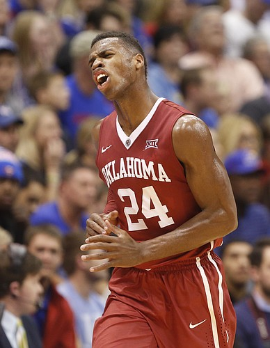 Oklahoma guard Buddy Hield (24) celebrates during the Sooners' comeback against Kansas during the second half on Monday, Jan. 19, 2015 at Allen Fieldhouse.