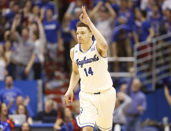 Kansas guard Brannen Greene throws up three fingers after sinking a three against Oklahoma to reclaim the lead late in the second half on Monday, Jan. 19, 2015 at Allen Fieldhouse.