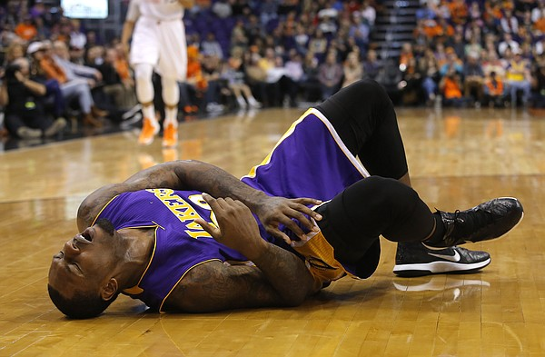 Los Angeles Lakers forward Tarik Black (28) reacts after getting hurt in the fourth quarter during an NBA basketball game against the Phoenix Suns, Monday, Jan. 19, 2015, in Phoenix. Black left the game and never returned. (AP Photo/Rick Scuteri)