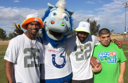 Former KU safety and Kansas City, Kansas native Darrell Stuckey — joined by New Orleans Saints RB Mark Ingram — takes time out for a photo at a Pro Bowl event earlier this week. (photo courtesy Indianapolis Colts mascot @blue)