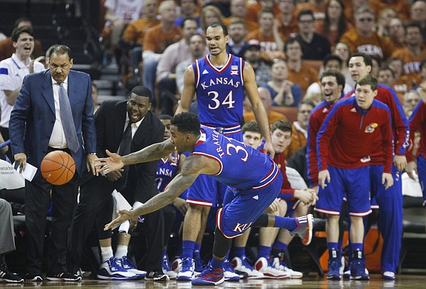 Kansas forward Jamari Traylor (31) dives out of bounds for an attempted save before the Jayhawks' bench during the first half, Saturday, Jan. 24, 2015 at Frank Erwin Center in Austin, Texas.