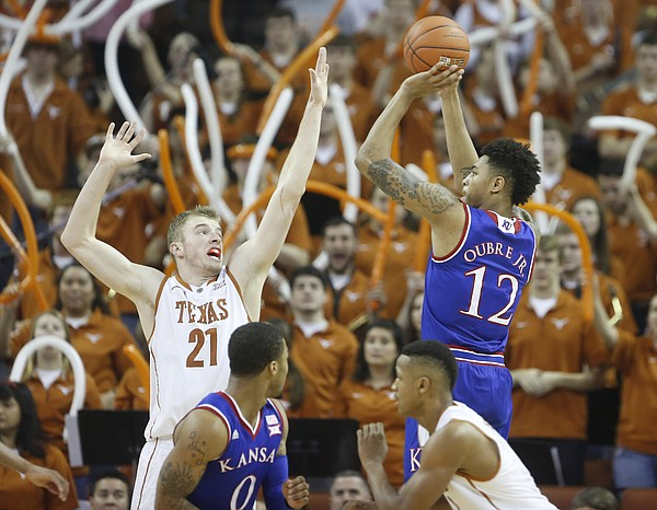 Kansas guard Kelly Oubre Jr. (12) puts up a shot over Texas forward Connor Lammert (21) during the second half, Saturday, Jan. 24, 2015 at Frank Erwin Center in Austin, Texas.