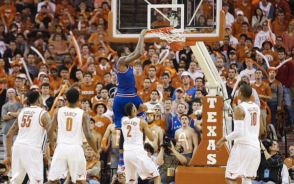 Kansas forward Cliff Alexander (2) delivers a dunk against the Texas zone defense late in the second half, Saturday, Jan. 24, 2015 at Frank Erwin Center in Austin, Texas.