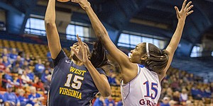 Kansas senior forward Chelsea Gardner blocks a shot by West Virginia sophomore center Lanay Montgomery during their game Saturday at Allen Fieldhouse. The Jayhawks defeated the Mountaineers, 65-59, for their second straight Big 12 win.