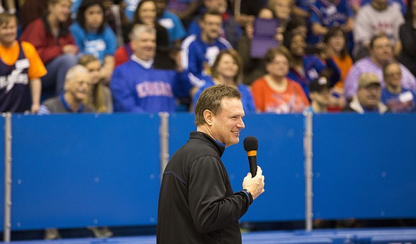 Kansas coach Bill Self flashes a smile as he introduces the team to the crowd during the 31st annual Wilt Chamberlain Special Olympics clinic, on Sunday, Jan. 25, 2015 at Allen Fieldhouse.