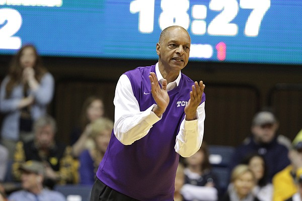 TCU head coach Trent Johnson encourages his players during the first half of an NCAA college basketball game against West Virginia, Saturday, Jan. 24, 2015, in Morgantown, W.Va. West Virginia defeated TCU 86-85 in overtime.