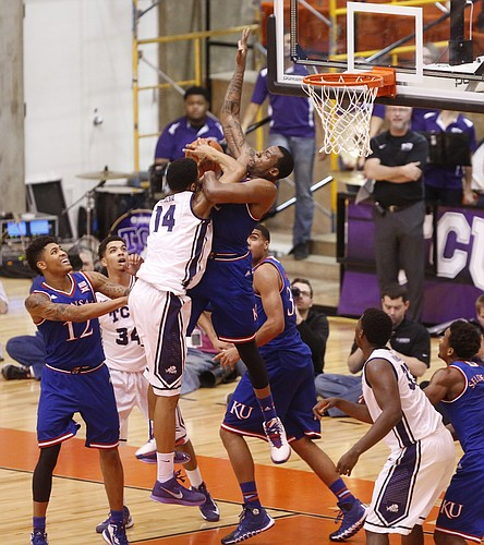 Kansas forward Cliff Alexander (2) wrestles under the bucket with TCU Horned Frogs center Karviar Shepherd (14) during the first half at Wilkerson-Greines Activity Center on Wednesday, Jan. 28, 2015 in Fort Worth, Texas.