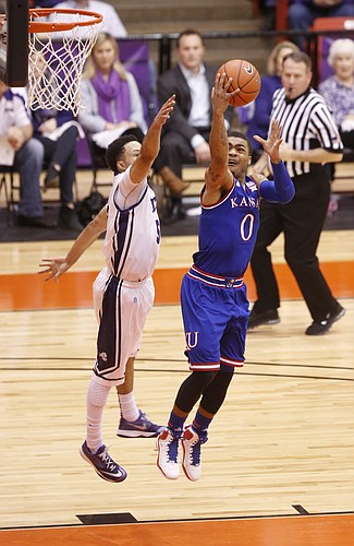 Kansas guard Frank Mason III (0) heads up to the bucket against TCU Horned Frogs guard Kyan Anderson (5) during the first half at Wilkerson-Greines Activity Center on Wednesday, Jan. 28, 2015 in Fort Worth, Texas.