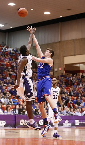 Kansas forward Hunter Mickelson (42) turns for a shot over TCU Horned Frogs forward Chris Washburn during the first half at Wilkerson-Greines Activity Center on Wednesday, Jan. 28, 2015 in Fort Worth, Texas.