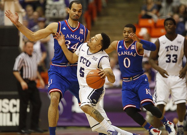 Kansas forward Perry Ellis (34) fouls TCU Horned Frogs guard Kyan Anderson (5) on a drive around the perimeter during the first half at Wilkerson-Greines Activity Center on Wednesday, Jan. 28, 2015 in Fort Worth, Texas.