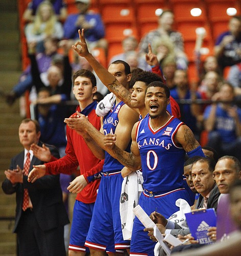 Kansas guard Frank Mason III (0) applauds a three from teammate Wayne Selden Jr. during the first half at Wilkerson-Greines Activity Center on Wednesday, Jan. 28, 2015 in Fort Worth, Texas.
