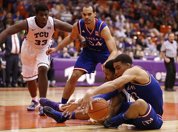 Kansas forward Landen Lucas battles for a loose ball with TCU Horned Frogs center Karviar Shepherd during the second half at Wilkerson-Greines Activity Center on Wednesday, Jan. 28, 2015 in Fort Worth, Texas. Also pictured are TCU Horned Frogs forward Chris Washburn (33) and Kansas forward Perry Ellis (34).