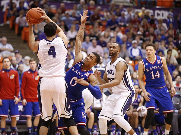 Kansas guard Frank Mason III (0) defends as TCU Horned Frogs forward Amric Fields (4) looks for an outlet pas to TCU guard Trey Zeigler during the second half at Wilkerson-Greines Activity Center on Wednesday, Jan. 28, 2015 in Fort Worth, Texas. At right is Kansas guard Brannen Greene (14).