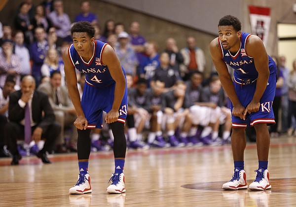 Kansas guards Devonte Graham (4) and Wayne Selden Jr. watch a pair of free throws from teammate Frank Mason with seconds remaining on Wednesday, Jan. 28, 2015 in Fort Worth, Texas.