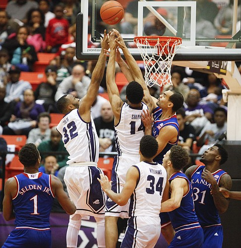 Kansas forward Perry Ellis battles down low for a rebound with TCU Horned Frogs guard Trey Zeigler (32) and center Karviar Shepherd during the second half at Wilkerson-Greines Activity Center on Wednesday, Jan. 28, 2015 in Fort Worth, Texas.