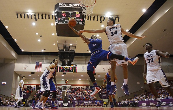 Kansas guard Frank Mason III (0) gets to the bucket against TCU Horned Frogs forward Kenrich Williams (34) during the second half at Wilkerson-Greines Activity Center on Wednesday, Jan. 28, 2015 in Fort Worth, Texas.