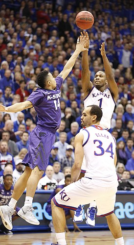 Kansas guard Wayne Selden Jr. (1) pulls up for a three pointer against Kansas State guard Justin Edwards (14) during the first half on Saturday, Jan. 31, 2015 at Allen Fieldhouse.