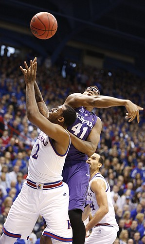 Kansas forward Cliff Alexander (2) battles to get off a shot against Kansas State forward Stephen Hurt (41) during the first half on Saturday, Jan. 31, 2015 at Allen Fieldhouse.