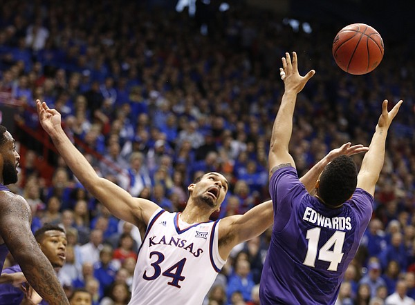 Kansas forward Perry Ellis (34) battles for a rebound with Kansas State guard Justin Edwards (14) during the first half on Saturday, Jan. 31, 2015 at Allen Fieldhouse.
