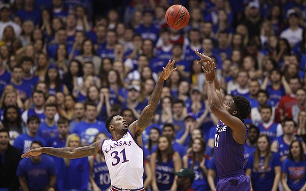 Kansas State forward Nino Williams (11) puts a shot over Kansas forward Jamari Traylor (31) during the first half on Saturday, Jan. 31, 2015 at Allen Fieldhouse.