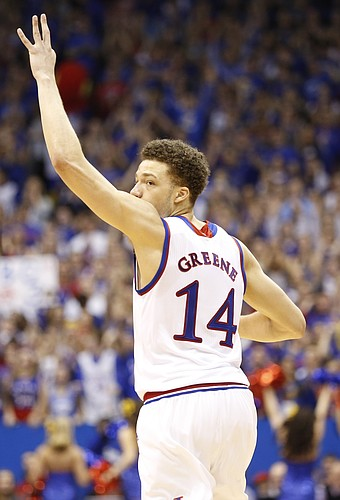 Kansas guard Brannen Greene (14) holds up three fingers after knocking down a three against Kansas State during the second half on Saturday, Jan. 31, 2015 at Allen Fieldhouse.