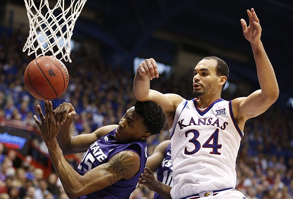 Kansas forward Perry Ellis (34) fights for a rebound with Kansas State forward Wesley Iwundu (25) during the second half on Saturday, Jan. 31, 2015 at Allen Fieldhouse.