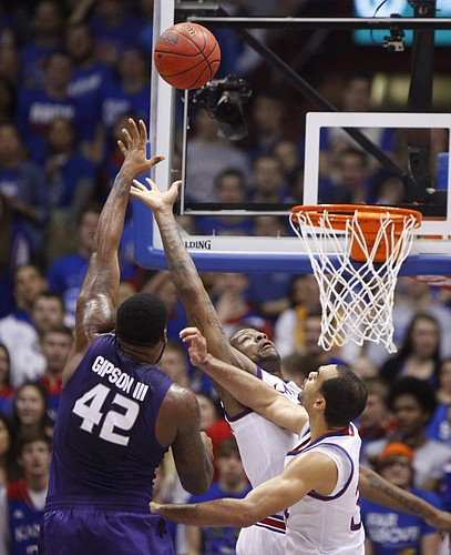Kansas State forward Thomas Gipson (42) puts up a shot over Kansas forward Perry Ellis, right, and forward Cliff Alexander during the first half on Saturday, Jan. 31, 2015 at Allen Fieldhouse.