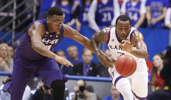 Kansas forward Cliff Alexander chases after a loose ball with Kansas State forward Stephen Hurt (41) during the first half on Saturday, Jan. 31, 2015 at Allen Fieldhouse.