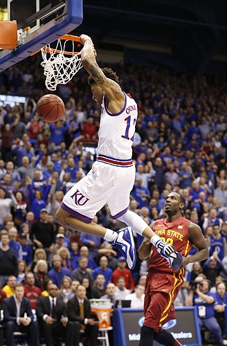 Kansas guard Kelly Oubre Jr. (12) delivers a dunk before Iowa State forward Dustin Hogue (22) during the first half on Monday, Feb. 2, 2015 at Allen Fieldhouse.