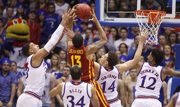 Kansas forward Landen Lucas, left, guards Brannen Greene, Kelly Oubre and forward Perry Ellis compete for a rebound with Iowa State guard Bryce Dejean-Jones during the first half on Monday, Feb. 2, 2015 at Allen Fieldhouse.