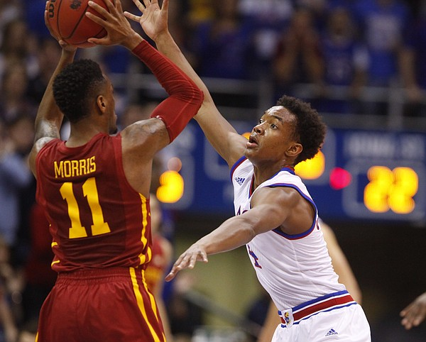 Kansas guard Devonte Graham (4) defends against a pass from Iowa State guard Monte Morris (11) during the first half on Monday, Feb. 2, 2015 at Allen Fieldhouse.
