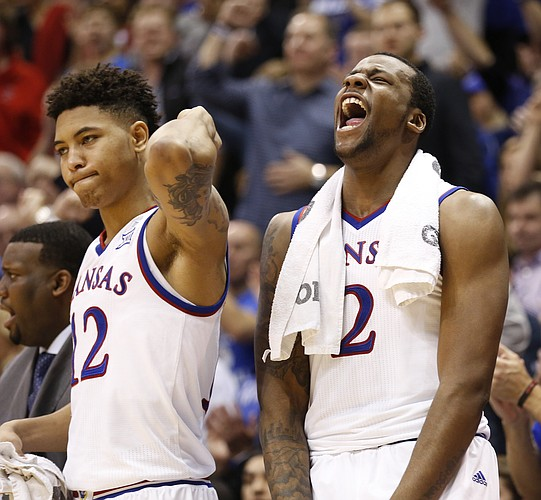 Kansas guard Kelly Oubre Jr. (12) and forward Cliff Alexander celebrate a three by teammate Wayne Selden Jr. during the second half on Monday, Feb. 2, 2015 at Allen Fieldhouse.
