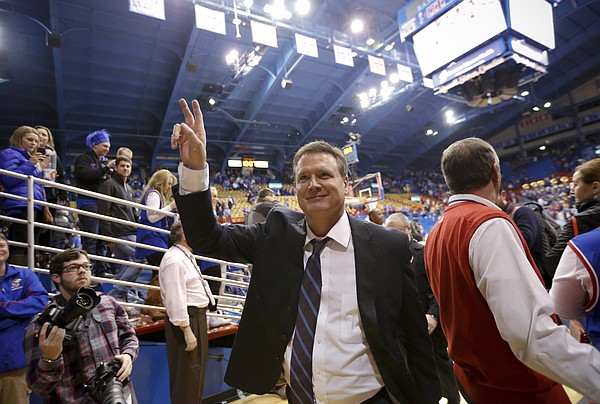 Kansas head coach Bill Self grins as he waves to the fans following the Jayhawks' 89-76 win over Iowa State on Monday, Feb. 2, 2015 at Allen Fieldhouse.