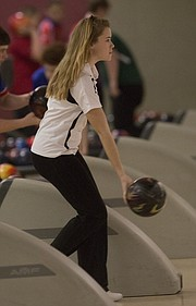 Free  condition  tall junior Maddy Dethloff eyes her delivery in a triangular bowling meet on Tuesday, Feb. 3, 2015, at Royal Crest Lanes.